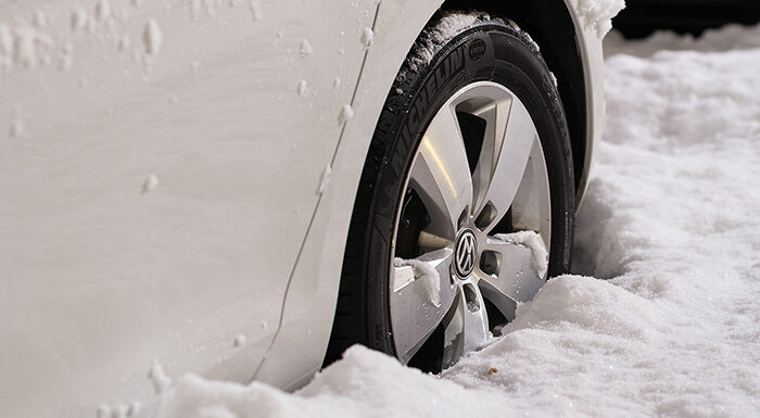 wheel of a white car stuck in the snow
